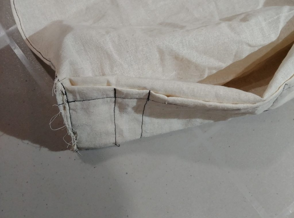 Sew top two layers together for narrow pockets
