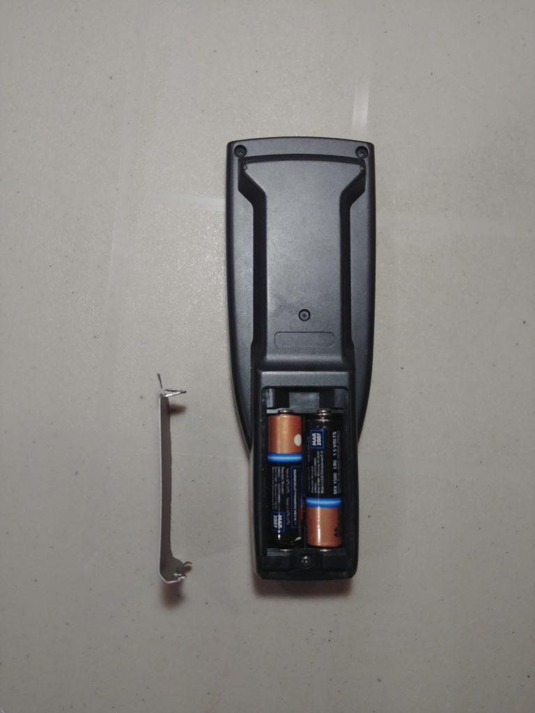 Remote Control with DIY Battery Cover made from aluminum siding sample