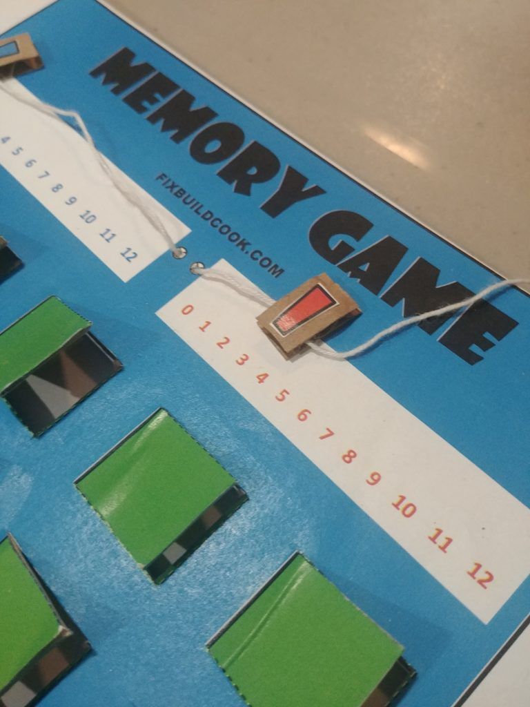 Stringing markers onto game board